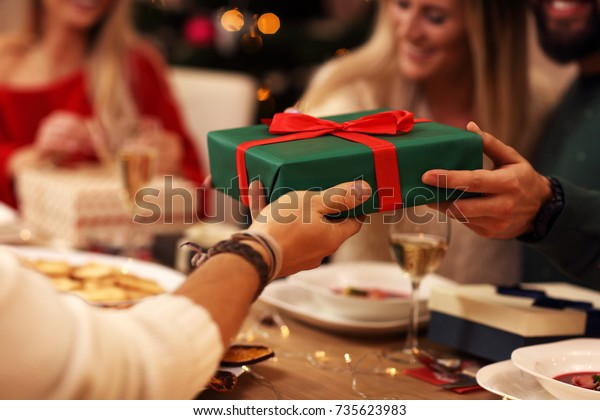 Group Friends Giving Christmas Presents Home Stock Photo Edit Now