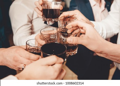 Group of friends guys with glasses of whiskey. Concept bachelor party