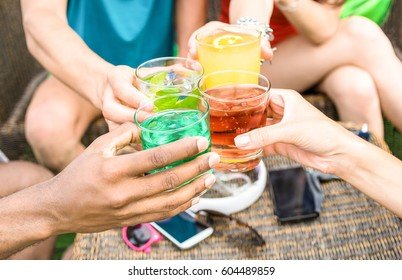 Group of friends hands drinking summer cocktails at beach bar restaurants - Side view point of young party people having fun together - Vacation and friendship concept - Warm color tone filter