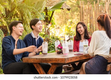 Group of friends hang out in cafe have fun together