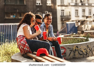 Group of friends hangout at the street.They drinking cold juice.Fast food.