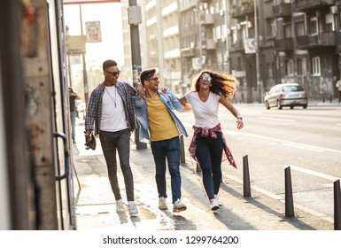 Group of friends hangout at the street.They embrace each other and walks around at the city downtown.