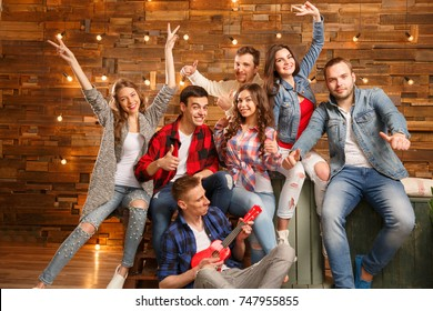 Group of  friends happy people, students  smiling, talking,  laughing, having fun at home party. Positive girls and boys Friendship between men and women.