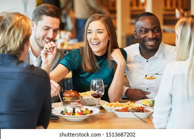 Group of friends has fun having a lunch together in the restaurant