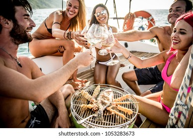 Group of friends having barbecue on the boat