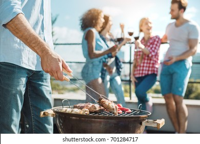 Group of friends having barbecue party on the roof