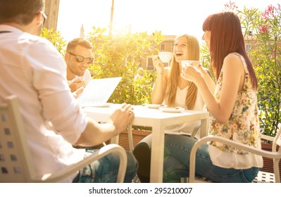 group of friends having a coffee outdoor and having fun. concept about friendship and people