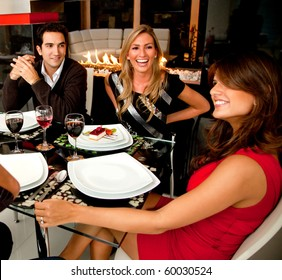 Group of friends having dinner in a nice restaurant