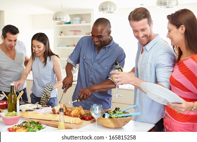 Group Of Friends Having Dinner Party At Home