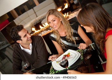 Group of friends having dinner at a restaurant