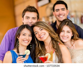 Group of friends having drinks at the bar