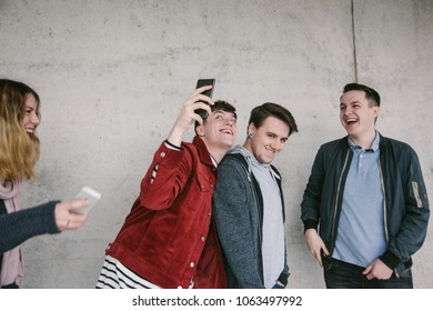 Group of Friends having Fun with each other while making Selfies with Smart Phone