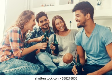 Group of friends having fun at home and enjoying together.