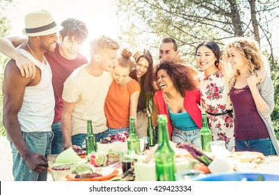 Group of friends having fun at the house barbecue. Eating and sharing good moods