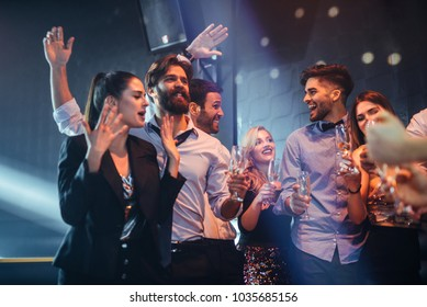 Group of friends having fun in the nightclub