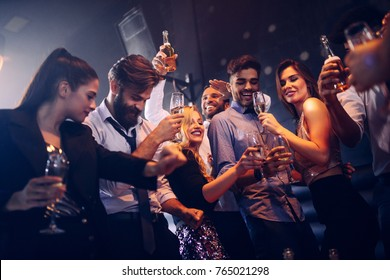 Group of friends having fun at the nightclub