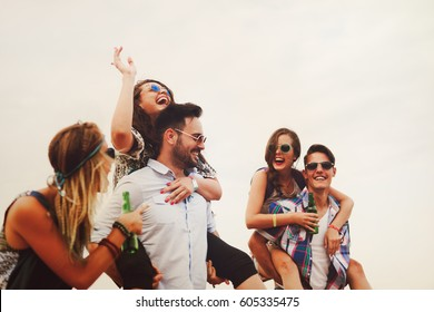 Group of friends having fun outdoors and are happy