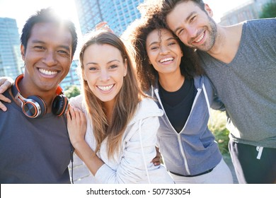 Group of friends having fun at the park ready to jog