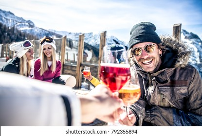 Group of friends having fun in a ski resort