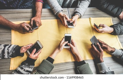 Group of friends having fun with smartphones - Closeup of hands social networking with mobile cellphones - Wifi connected people, technology, millennial and z generation concept