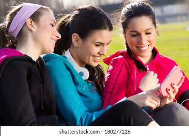 A group of friends having fun with smartphones after exercise