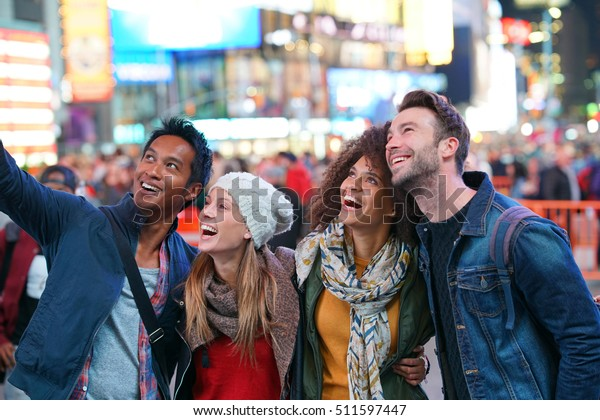 Group of friends having fun at Times Square, NYC