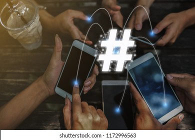 Group of friends having fun together with smartphones - Closeup of hands social networking with mobile cellphones. concept hashtag