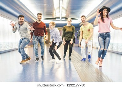 Group of friends having fun together in underground station - Young people getting ready for party - Happiness, nightlife, friendship and youth lifestyle concept