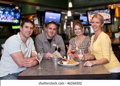 Group of friends having fun in a trendy bar.