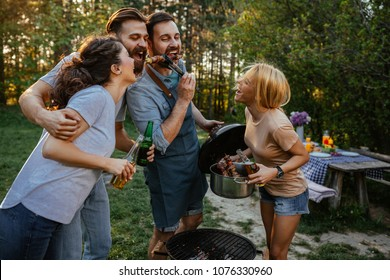 Group of friends having fun trying barbecue