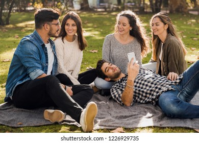 Group of friends having  a great day in the park