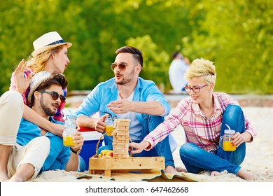 A group of friends having great time together on the beach.