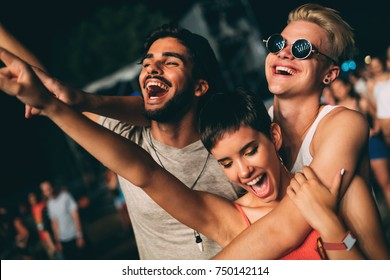 Group of friends having great time on music festival
