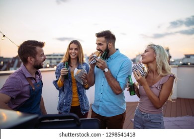 Group of friends having meal at the rooftop