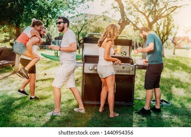 Group of friends having an outdoor garden barbecue. People having a good time, laughing and smiling