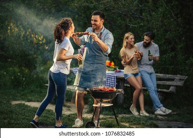 Group of friends having picnic in the park