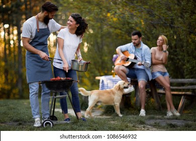 Group of friends having picnic in the park.