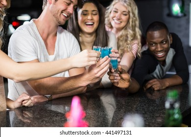 Group of friends having shots in a nightclub