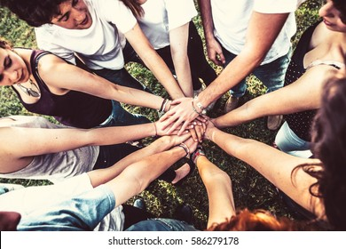 Group of Friends Holding Hands Together. Teamwork Concept