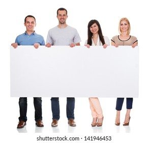 Group Of Friends Holding Placard On White Background