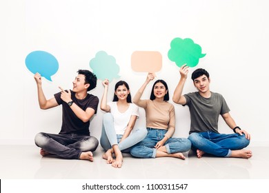 Group of friends holding a speech bubble icon