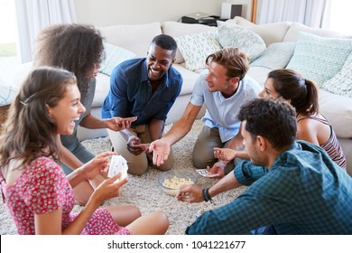 Group Of Friends At Home Playing Cards Together