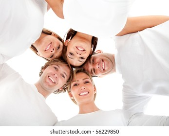 Group of friends hugging in a circle - isolated over a white background