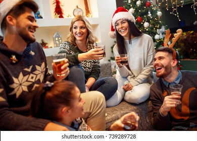 Group of friends laughing on Christmas Party