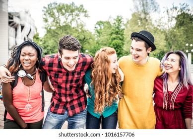 Group of  friends laughing out loud outdoor, sharing good and positive mood.