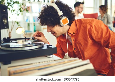 Group of friends listening music - vinyl at home