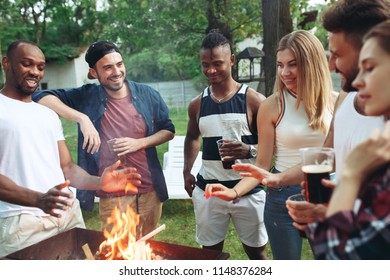 Group of friends making barbecue in the backyard. concept about good and positive emotions. Enjoying forest party with friends. Summer, party, adventure, youth, frienship concept