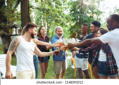 Group of friends making barbecue at the backyard. concept about good and positive emotions. Enjoying forest party with friends. Summer, party, adventure, youth, frienship concept