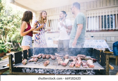 Group of friends making barbeque in the backyard. concept about good and positive mood with friends