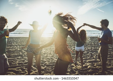 Group of friends making beach party and a bone fire in front the ocean. Summer lifestyle concept
